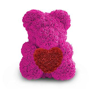 Мишка с сердцем розового цвета